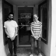 Graphic Designer Estbean Gonzalez and Owner SB in the doorway of Lightning Bolt Ink. Photo: Erin Fowler