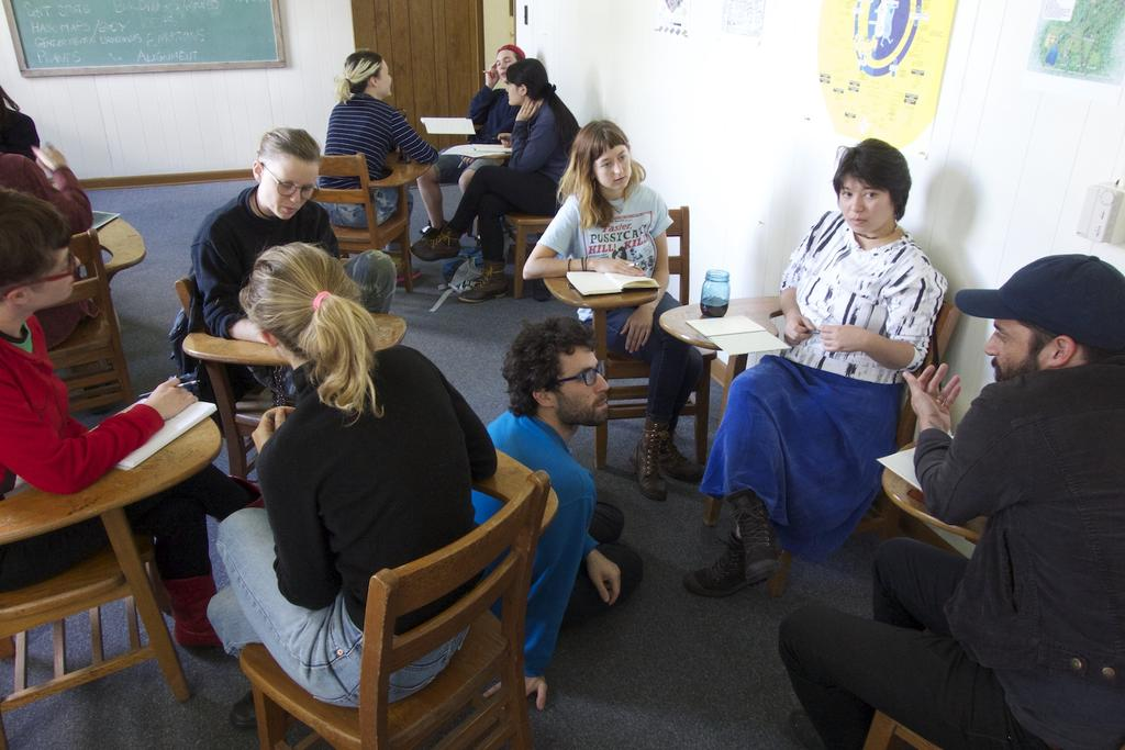 Joe Ahearn (pictured in blue sweatshirt) talking with students during his class, Analog Data Management class. Photo by Faythe Levine