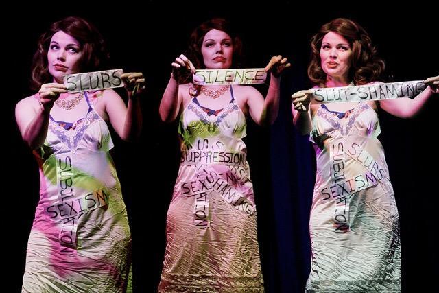 "Queen April performs a powerful burlesque piece during ""Asheville Vaudeville Gets Political, November 2016"
