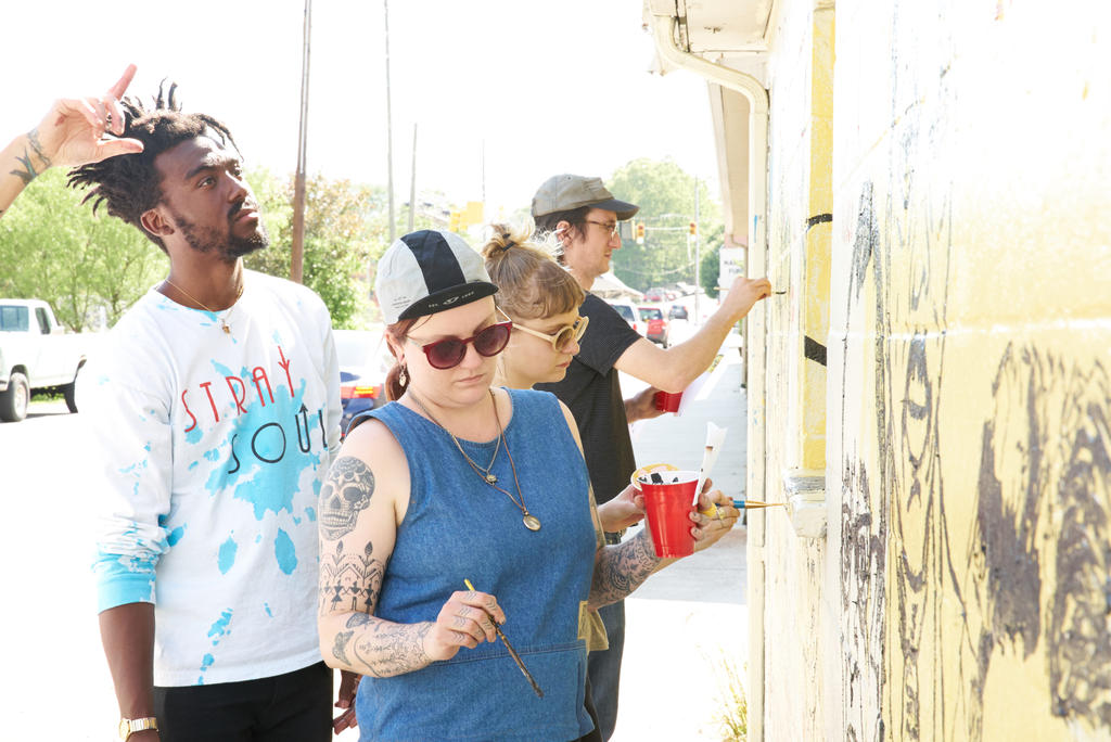Students working during Tim Kerr's Mural Painting class, which created a mural honoring BMC  in Downtown Black Mountain. Photo by Suzi Sadler